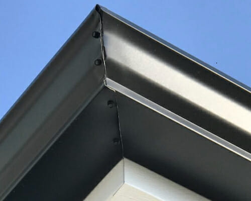 hand-cut metal roof corner