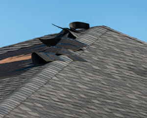 shingles ripped off of roof from wind damage
