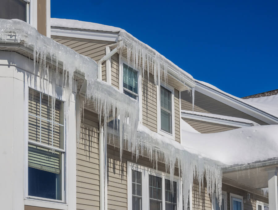 ice dams on the roof of a house